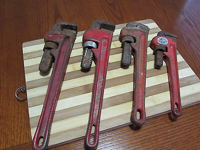 "4 Adjustable Pipe Wrenches 10""; 12""; 14; & 14"""
