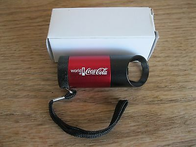 World of Coca-Cola mini flashlight and bottle opener NIB
