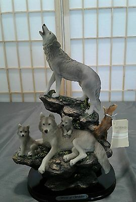 Howling Wolf and Family on a Rock STATUE