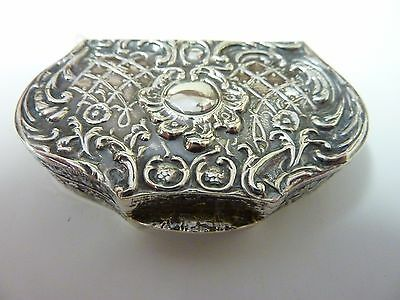 Unusual solid silver pill box embossed lid decoration