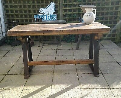 vintage wooden work bench with cast iron legs