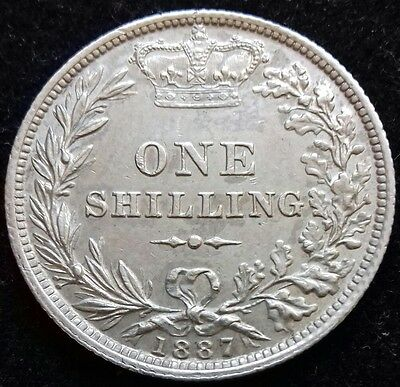 1887 Young Head Shilling. Rarer Type. S.3907. Almost Extremely Fine.
