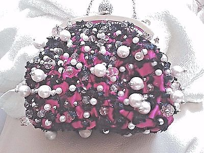 hand made .PURSE WITH A LOT OF CRYSTAL BIDS   . MADE BY ''GALA''