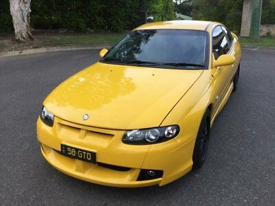 2002 Holden Special Vehicles Coupe V2 GTO Devil Yellow Manual 6sp M Coupe