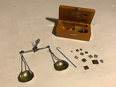Antique apothecary scale with some weights