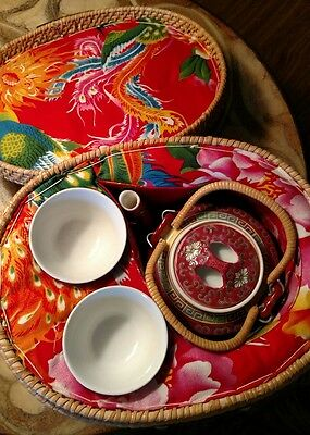 Teapot and cups in a warming wicker basket