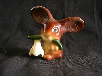 ceramic rabbit with flower in mouth