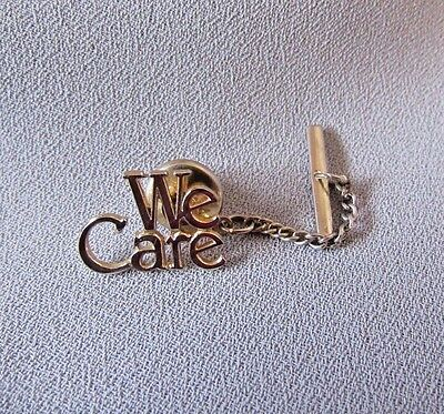 """we Care"" Gold Tone Tie Stud With Button Chain"