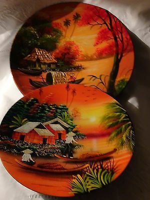 Set of 2 19th century Hand Painted oil on liquor Wall Hanging Plates.