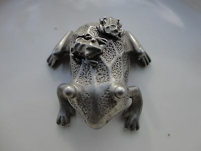 Pewter Frog figurine holding baby frog earings on back with charm inside