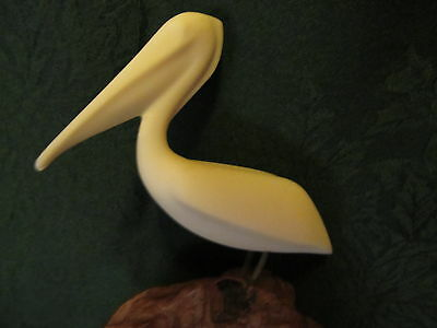 Individual Pelican Sculpture by John Perry On Burl Wood