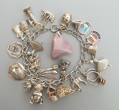 Vintage / modern sterling silver charm bracelet with 22 charms (61.45g)