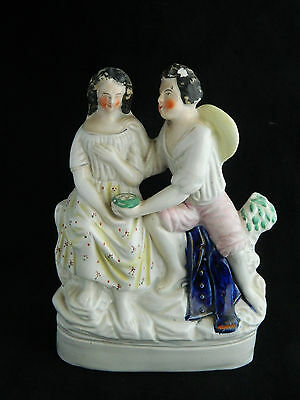 Antique English Staffordshire pottery flatback figurine of couple and birds nest
