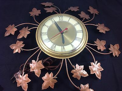 Vintage UNITED Retro Mid Century Electric Wall Clock Leaves Model 77 works