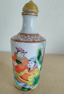 A ceramic chinese snuff bottle with painted scene decoration