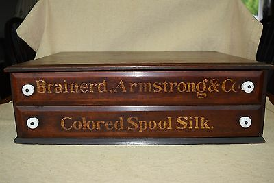 Brainerd, Armstrong & Co. Walnut Country Store Spool / Sewing Cabinet