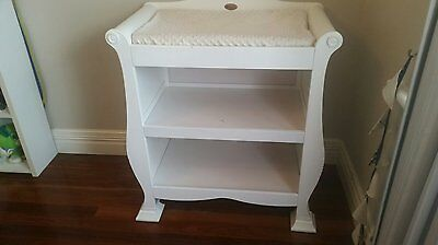 White sleigh change table with change pad