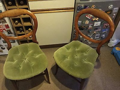 Pair of antique chairs with pale green velvet seats
