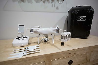 DJI Phantom 4 drone stacked with extras