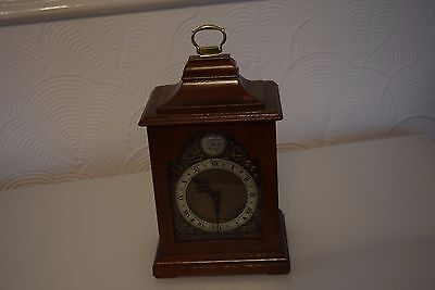 antique small bracket clock in a wooden case