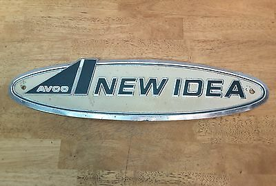 AVCO New Idea Embossed Metal Sign Tractor Combine Farm Implement Advertising