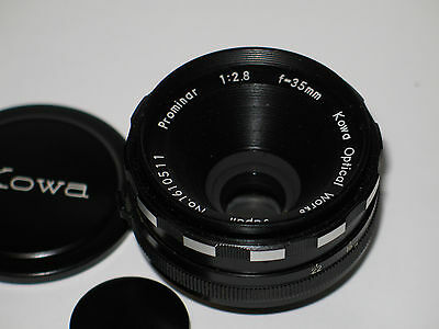 Vintage Kowa Prominar 35mm 2.8 Lens with caps and case. Exc+++