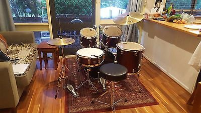 Mapex Drums Red with cymbals, throne and drum silencing pads.