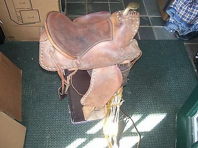 western pony saddle with wooden sturps as found