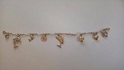 9ct Yellow Gold Charm Bracelet with 7 charms