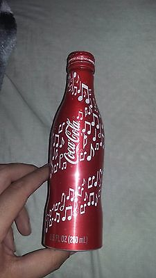 rare aluminum 8.5 oz coca cola music notes bottle empty