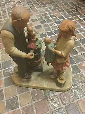 "norman rockwell figurine ""the curosity shop"" from the gift world of gorham"