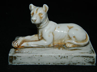 Antique small Continental porcelain blanc de Chine style recumbent dog figurine