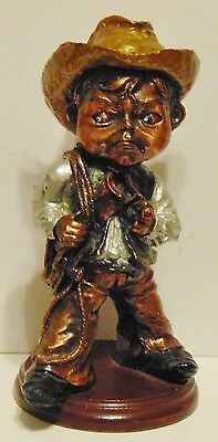"Cowboy figurine boy with cigar unique rare 7 3/4"" metallic look"