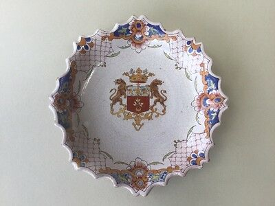 A French Malicorne Faience Armorial Wall Plate