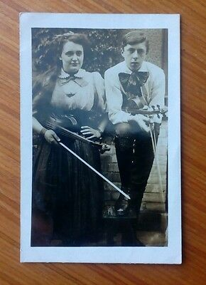 Vintage* Gentleman and lady with violins and bows. Real photo.