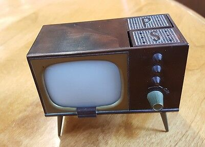 1950's console television salt and pepper shakers turn knob raise shakers