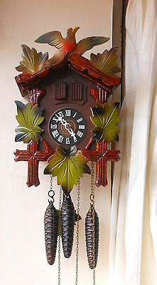 Vintage three train Black forest cuckoo clock also plays music.