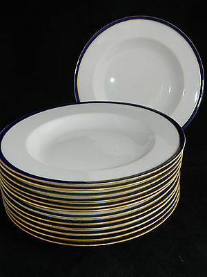 A lot of 13 antique Cauldon Ltd porcelain soup bowls / plates