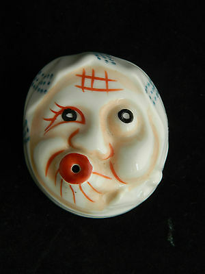 A rare 1940's vintage porcelain pie funnel with character face