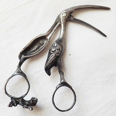 BEAUTIFUL ANTIQUE TIN MIDWIFE STORK UMBILICAL SCISSOR WITH BABY 1900's