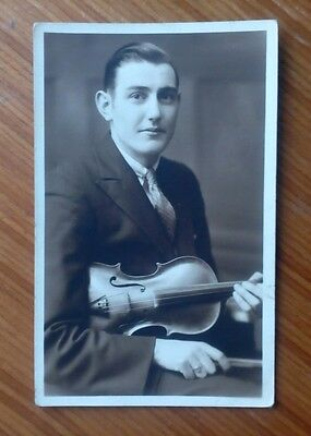 Vintage* Gentleman with a violin and bow. Nice condition.