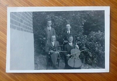 Vintage* Four gentlemen with violins, bows and cello. Nice photo.
