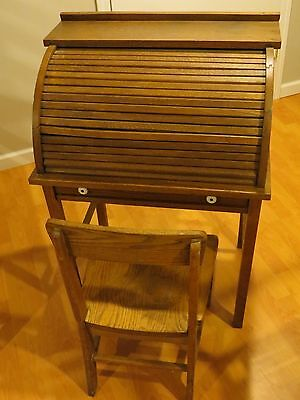 Antique child's roll top oak desk with chair