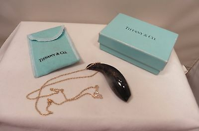 A GOOD BOXED TIFFANY AND Co, FRANK GEHRY, FSIH JADE NECKLACE..