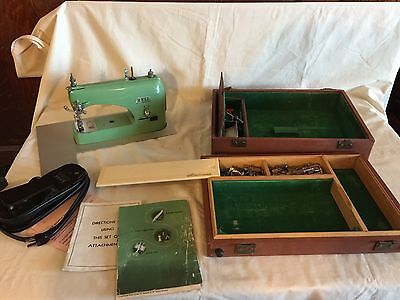 Vintage Bell Portable Sewing Machine with Parts & Accessories w/Carry Case used