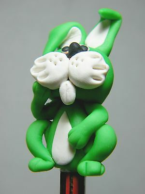 Polymer Clay Lovely Green Rabbit Figurine Act On Top Of Wooden Pencil