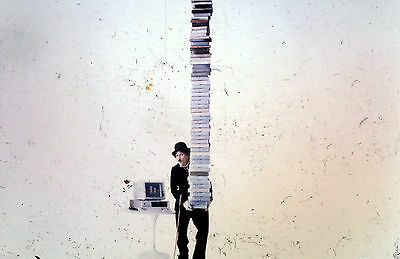 """ITHistory (1984) Slide/ Photo: IBM PC """"Charlie Chaplin with a stack of software"""""""