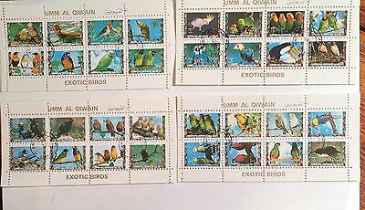 Postage stamps Umm Al Qiwain 4 blocks 24 exotic birds cancelled 1973