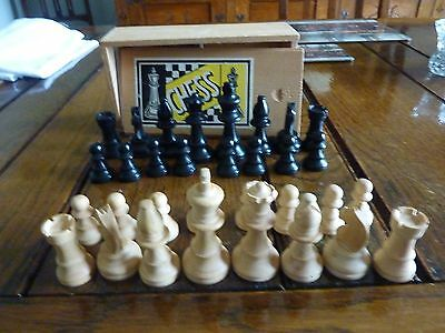 Vintage wooden set of chess pieces in damaged box