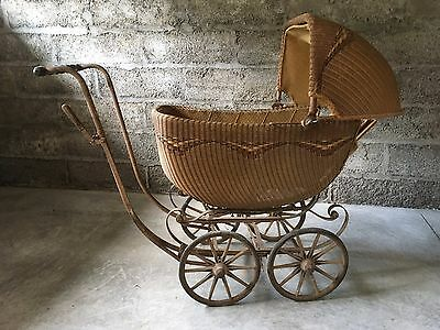 Antique wicker baby carriage buggy